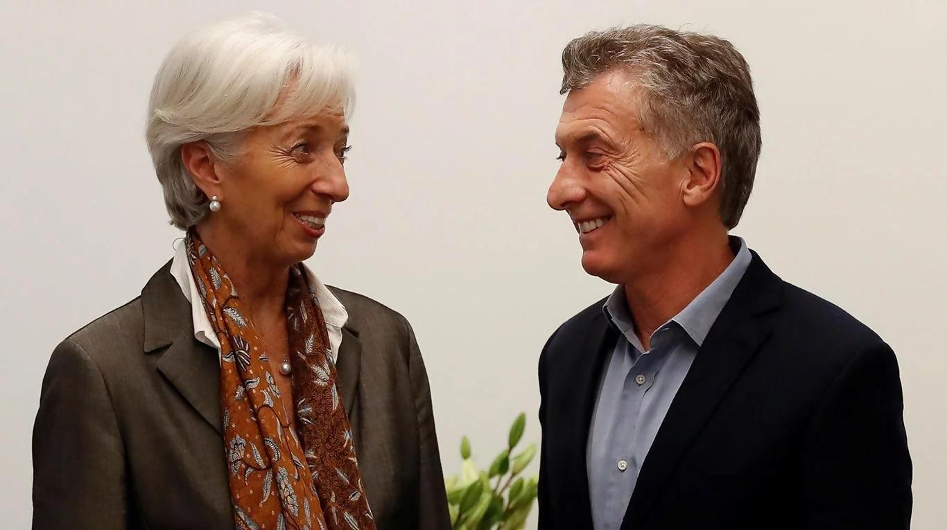 M.Macri y la titular del FMI, C. Lagarde, sonriendo con complicidad.